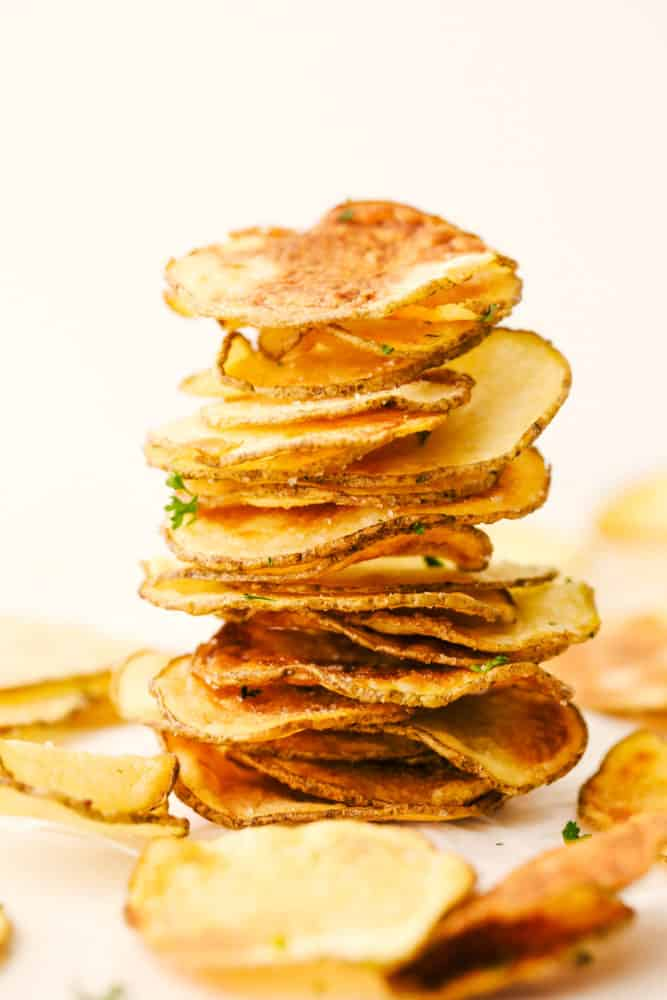 Air fryer potato chips stacked and ready to eat.