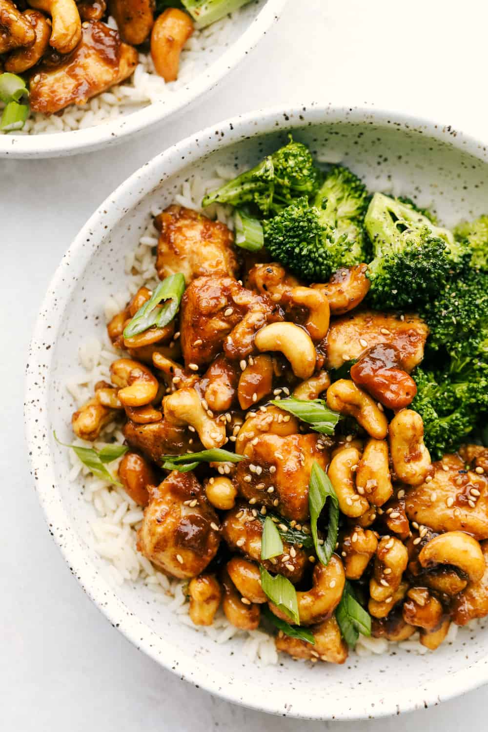 Cashew chicken on bed of rice with broccoli