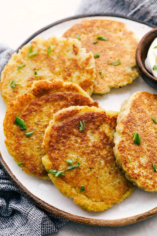 Crispy savory potato pancakes on a plate.