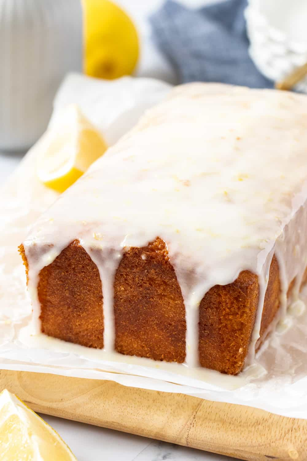 A loaf cake with glaze dripping down the sides.