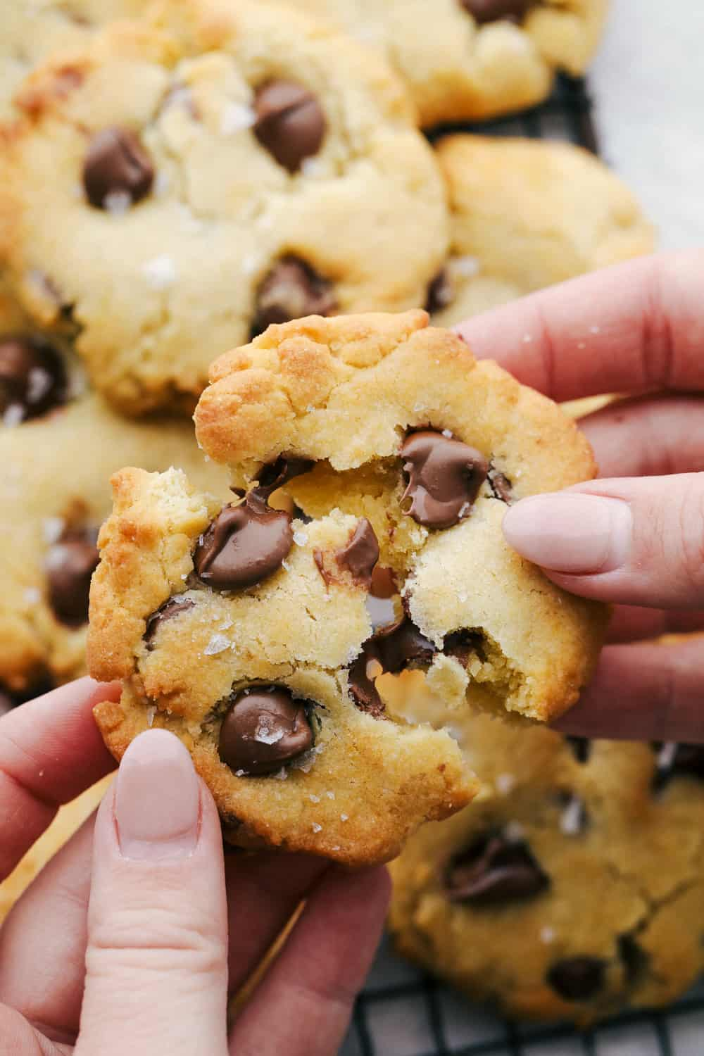 Breaking apart a cookie with melting chocolate.