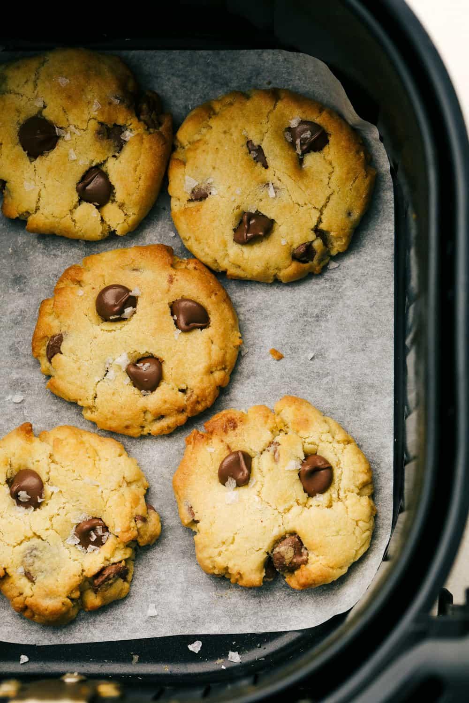 Golden brown cookies in the air fryer basket.