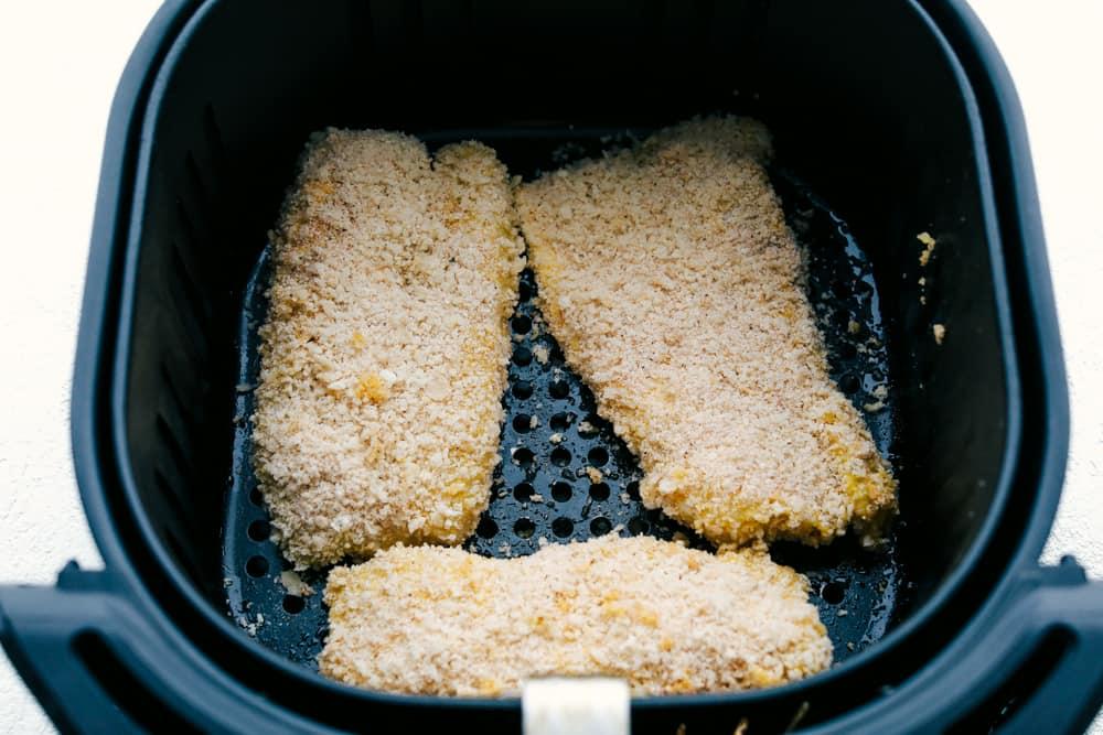 Breaded panko in air fryer basket.