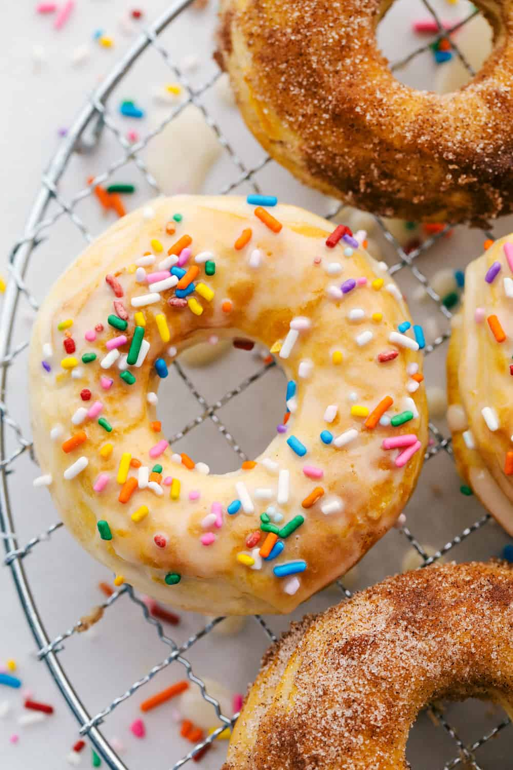 Glazed and cinnamon and sugar air fryer donuts.