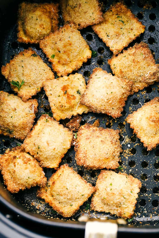 Air fryer ravioli in the air fryer basket.