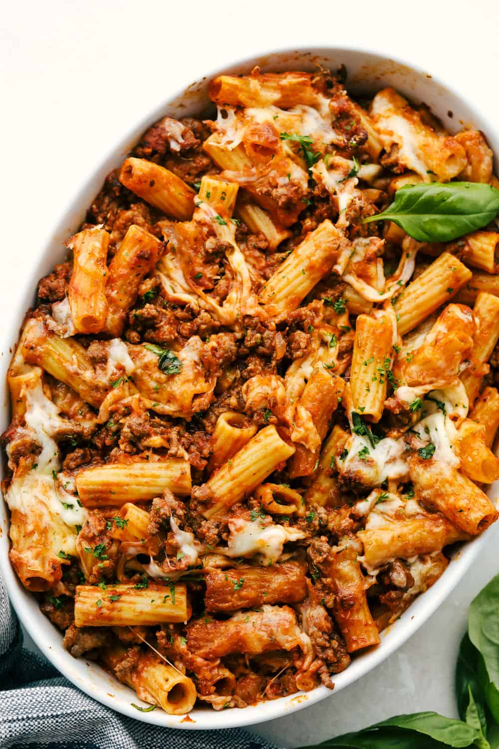 Baked rigatoni in a white bowl.