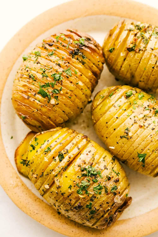 Crispy air fryer hasselback potatoes on a plate.