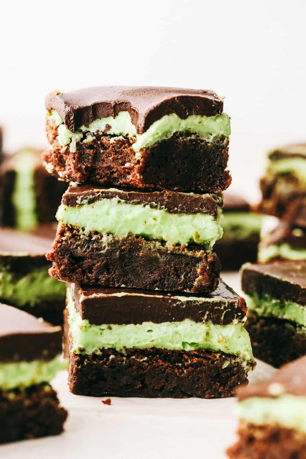 Mint brownies stacked on top of each other.