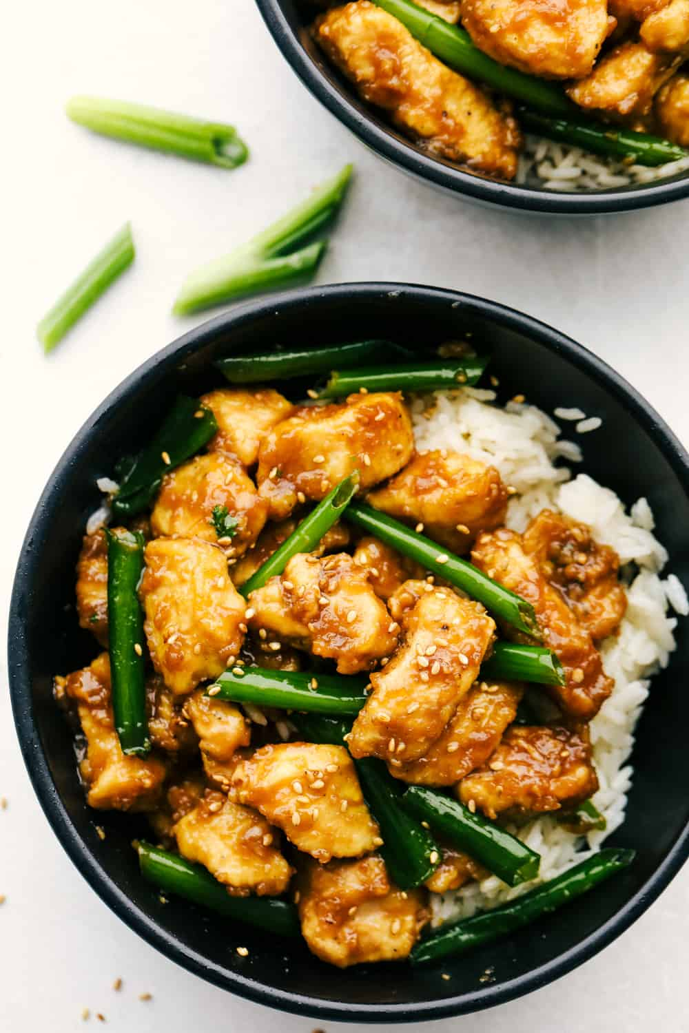 Mongolian chicken in bowl with rice.