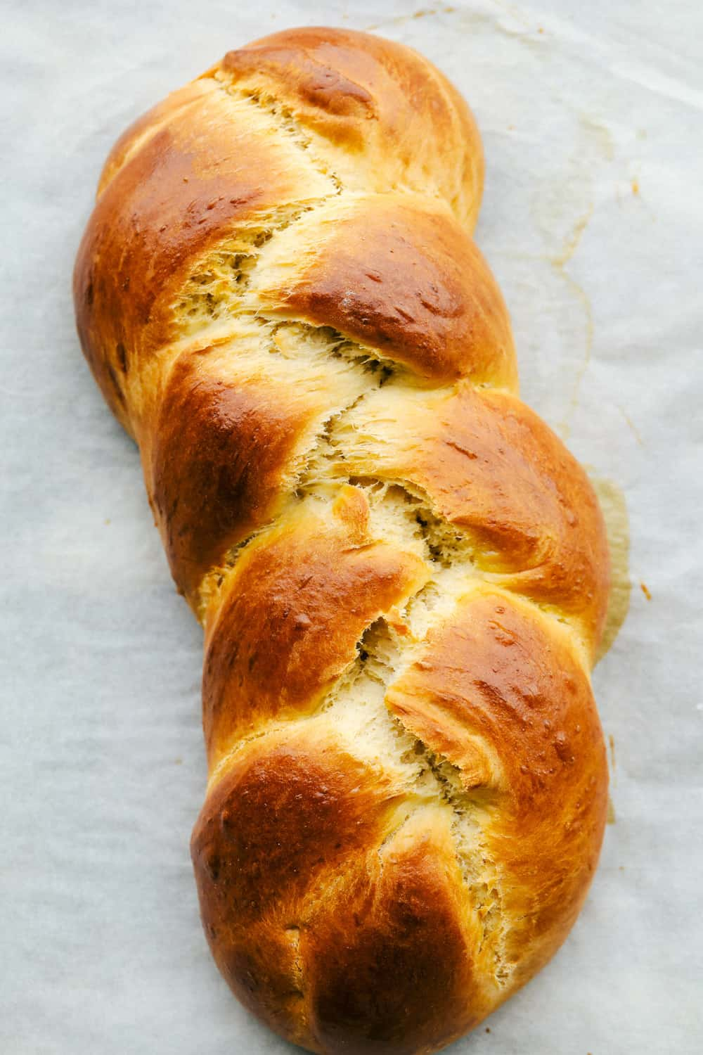 Golden brown baked challah bread.