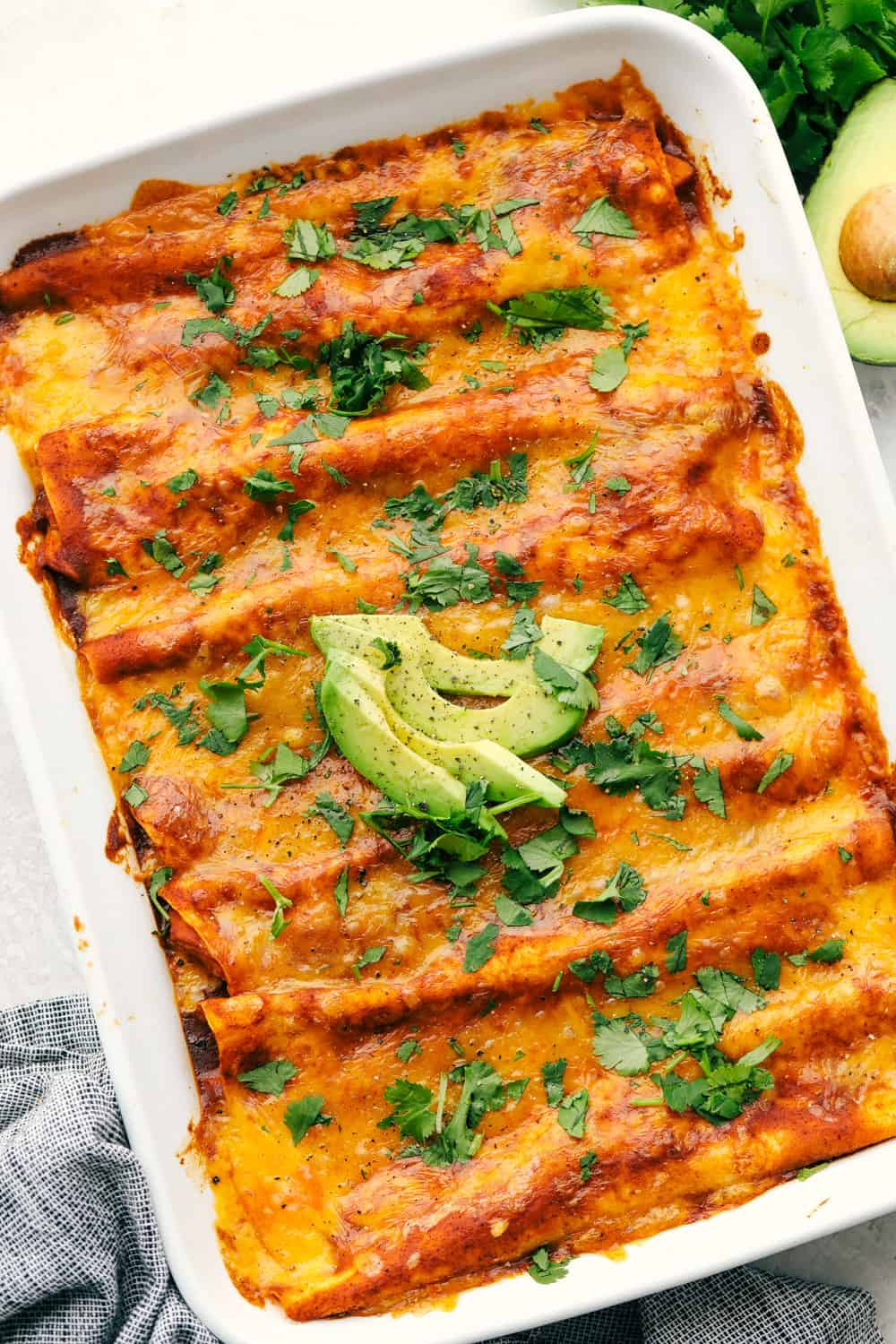 A pan of cheesy chicken enchiladas.