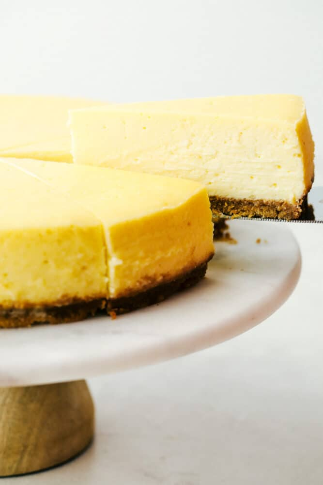 A slice of New York cheesecake being served.