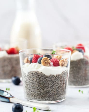 Closeup of a glass filled with chia pudding, yoghurt and berries