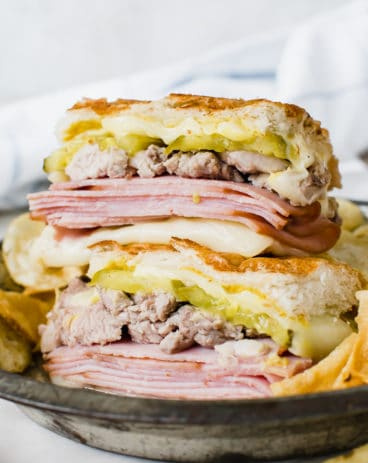 cuban sandwich stacked on top of each other on metal plate
