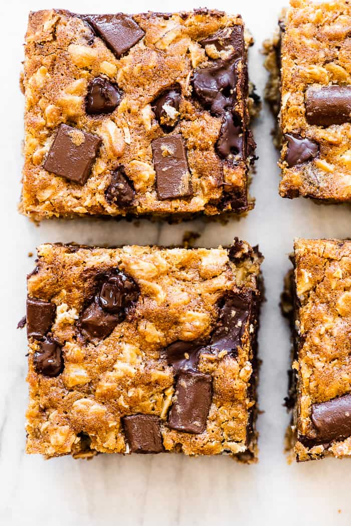 Oatmeal chocolate chip bars on a marble countertop.