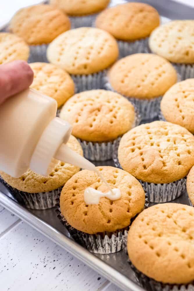 3 milk mixture soaking into cupcakes
