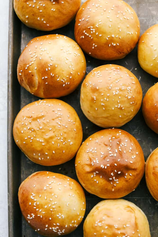 Baked Hamburger buns on a tray.