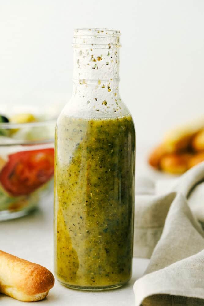 Olive garden salad dressing in a glass jar,