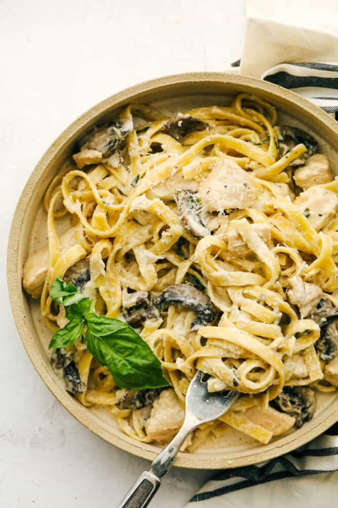 Chicken and Mushroom Fettuccine Alfredo is an easy weeknight or weekend meal made even faster if you have leftover chicken. One-pot means keeping this simple while everything is simmered together.