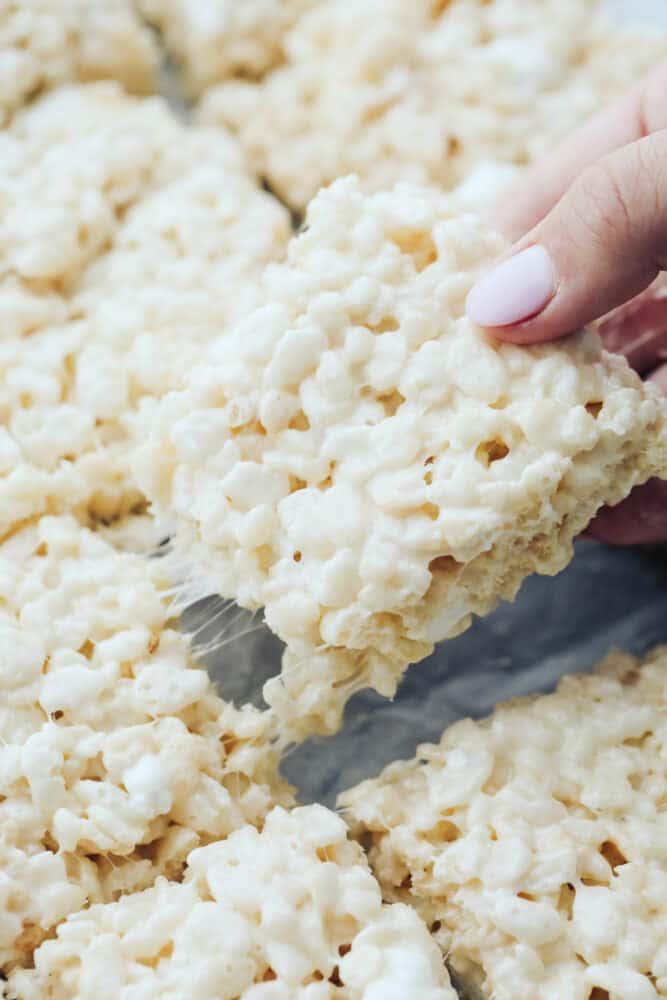 Rice krispie being pulled from pan