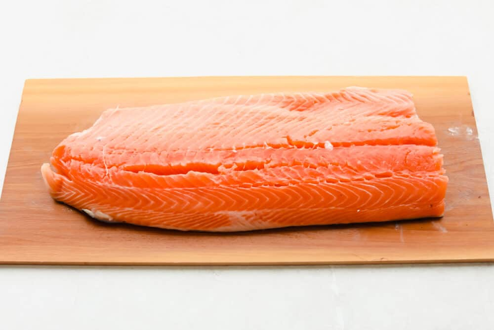 A fresh cut of salmon on cedar plank.