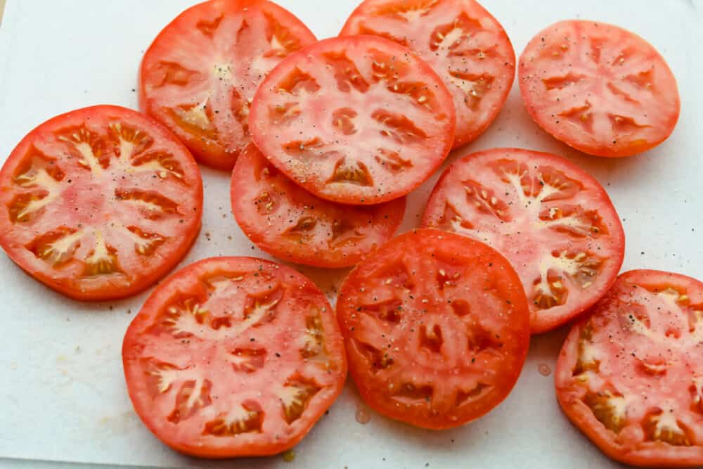 Raw tomatoes salted and peppered