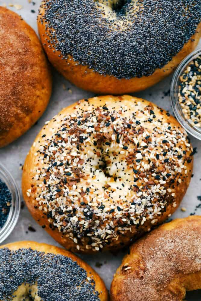 Up close picture of two bagels with poppy seed and everything seasoning.