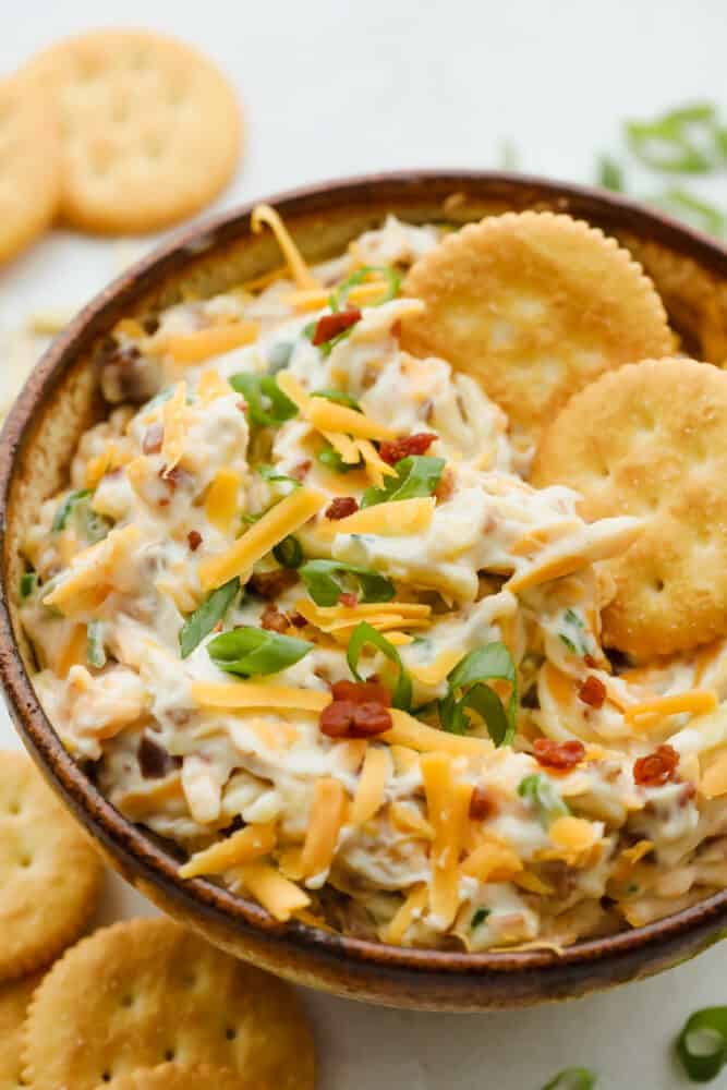 Bowl of million dollar dip with crackers.