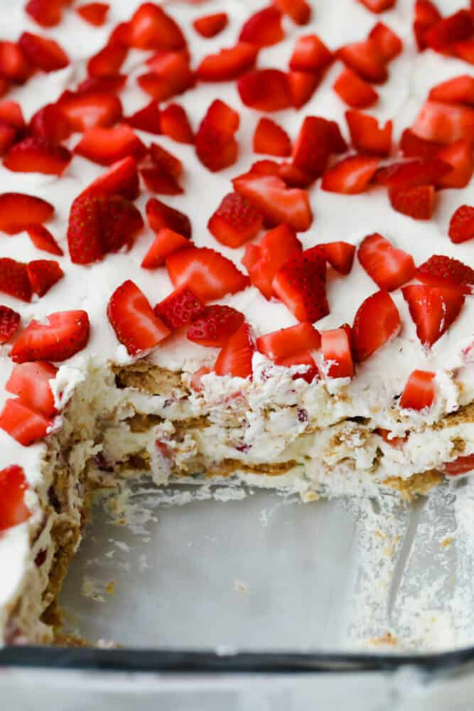 Strawberry icebox cake with piece cut out.