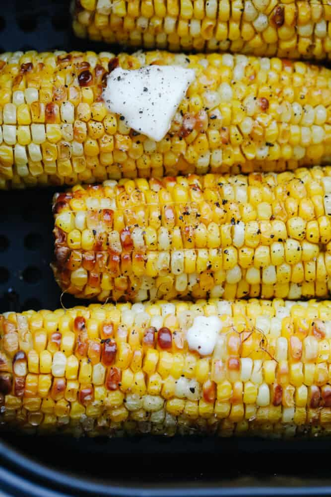 Air fried corn on the cob with butter.