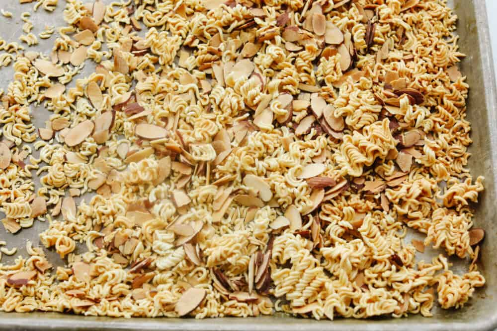 Toasting the almonds and noodles for crunch and flavor.