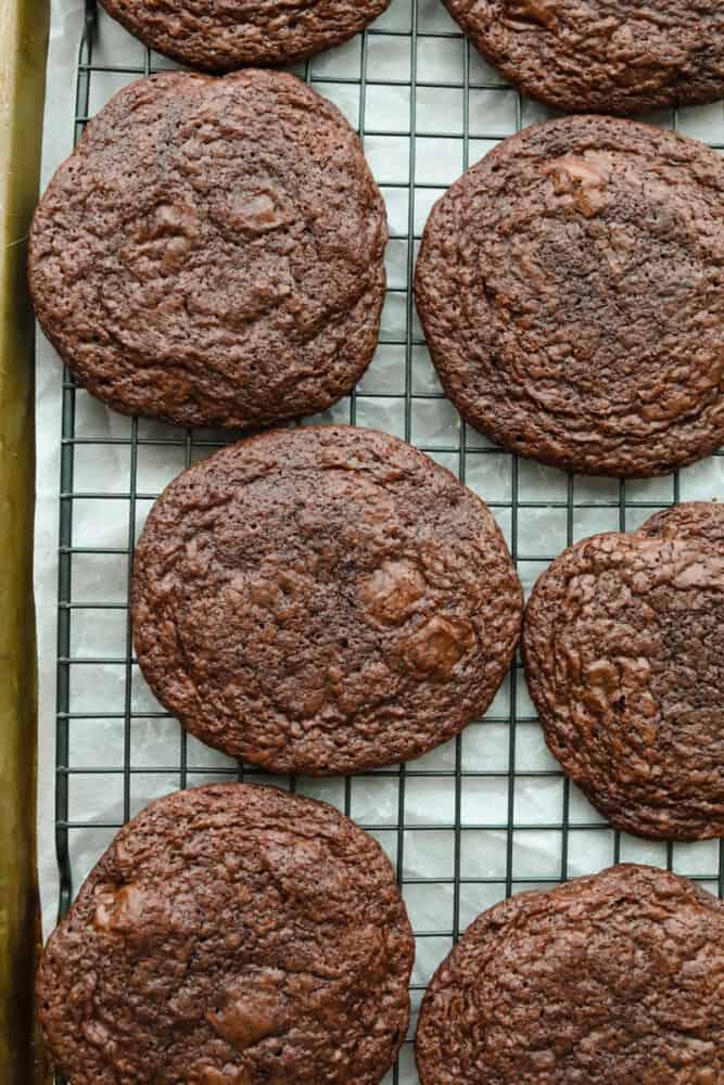 Baked brownie cookies on baking sheet.