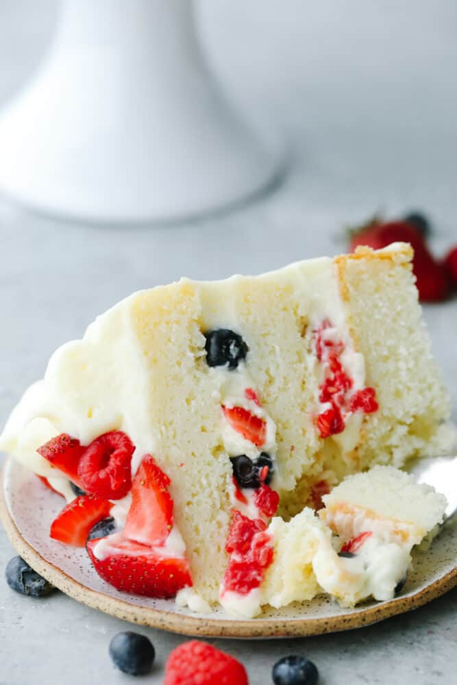 Close up of a slice of Chantilly Berry Cake.