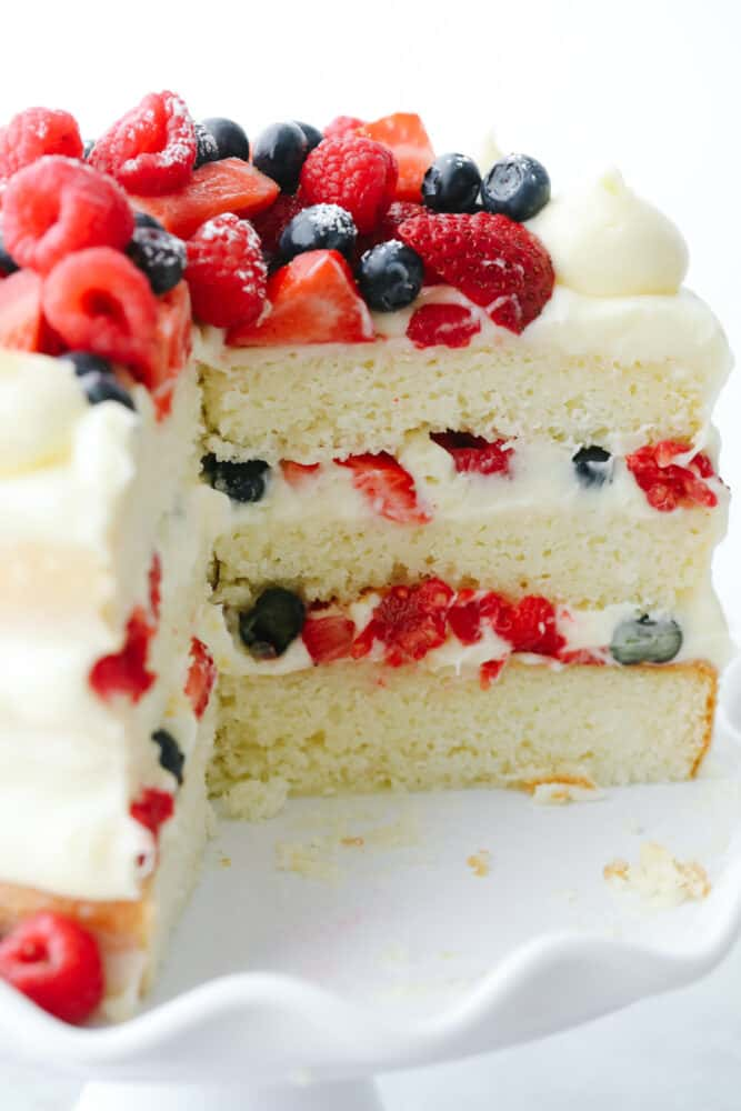 Piece cut out of Chantilly Berry Cake.