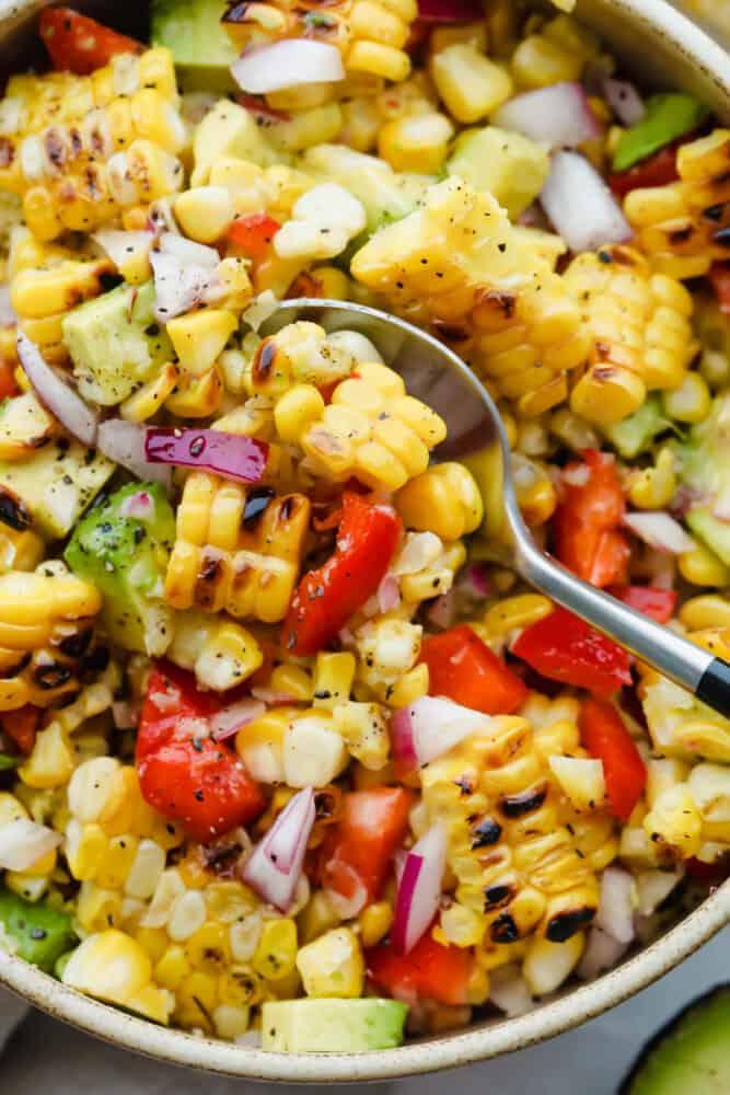 Spooning a scoop of summer corn salad.