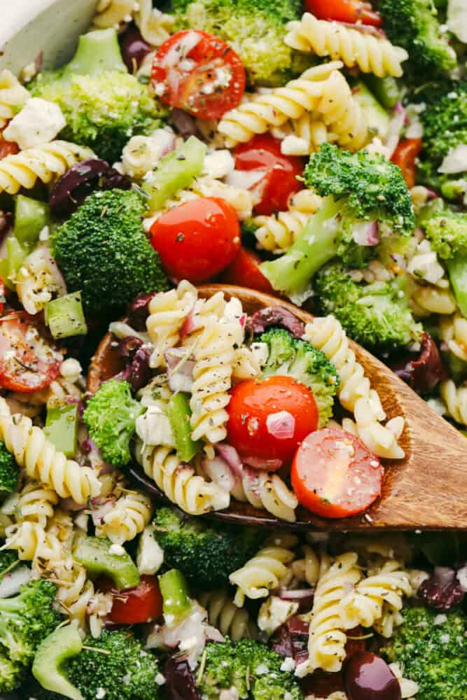 Taking a scoop of Greek broccoli pasta salad.
