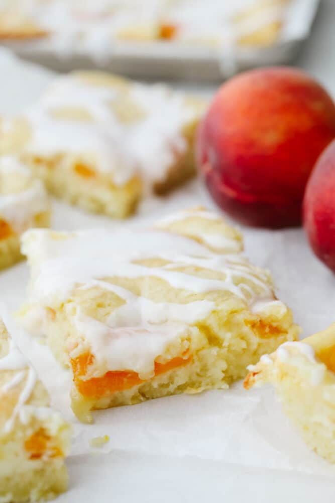 Peaches and cream pie bars on parchment paper.