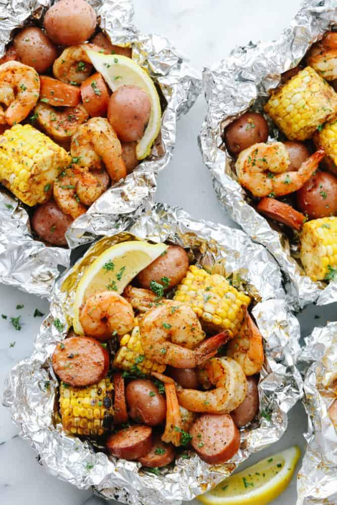 Shrimp Boil Foil Packets with lemon garnish.