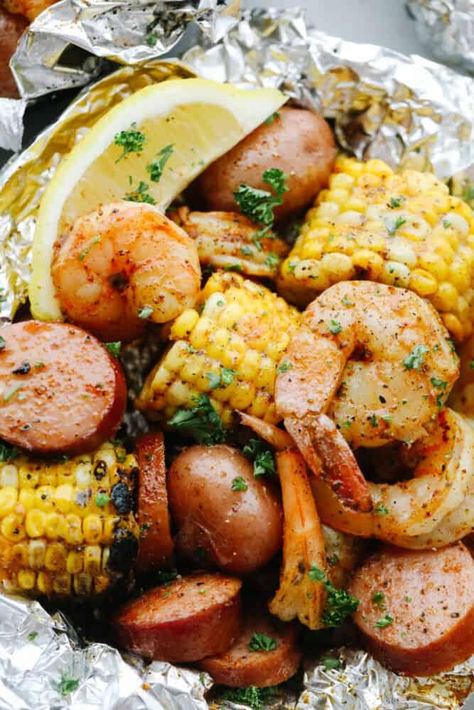 Close-up of Shrimp Boil Foil Packet with lemon garnish.