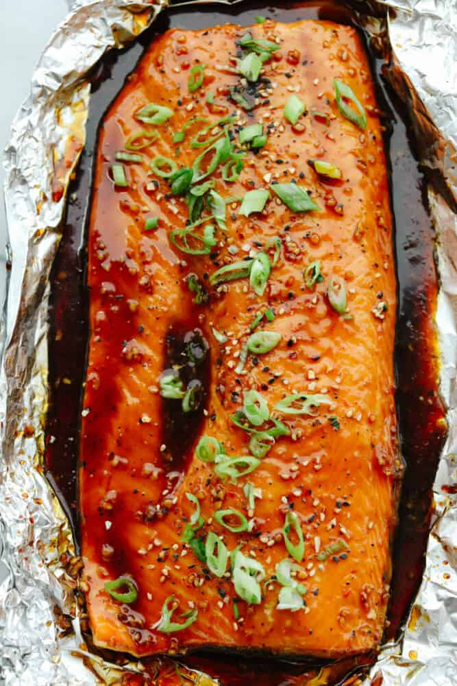 Salmon in tin foil covered in glaze.