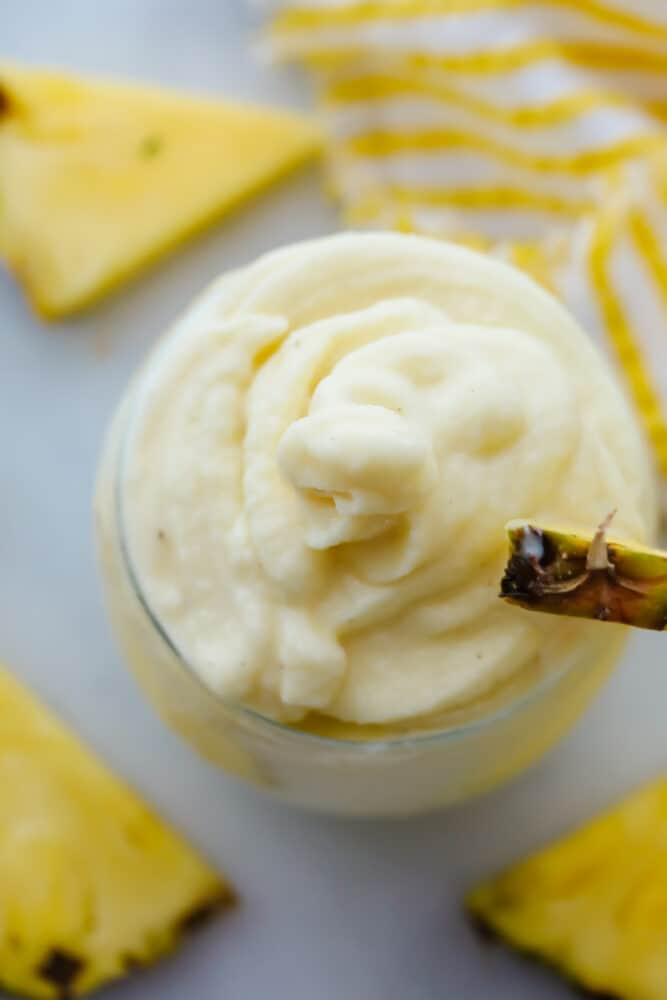 Creamy texture of a pineapple whip up close.