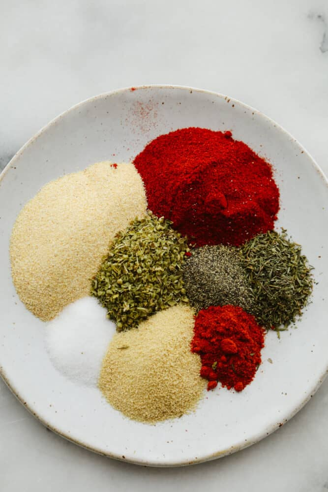 Spices ready to be mixed together in a bowl.