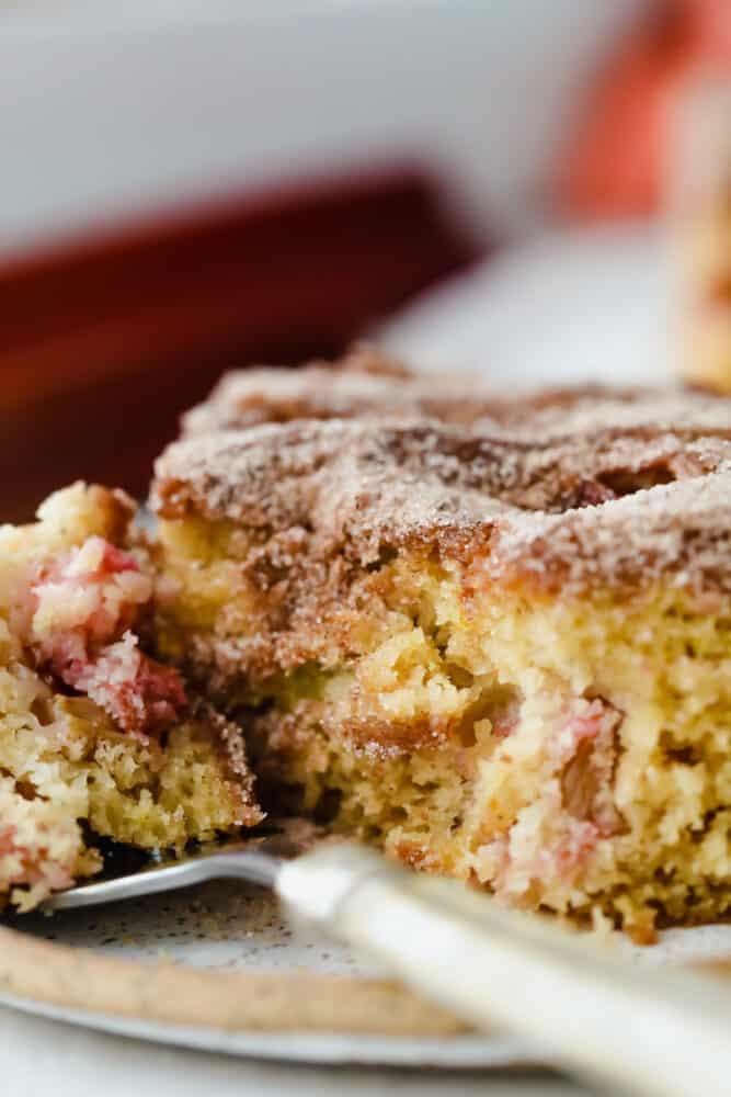 Cinnamon sugar rhubarb cake being served on a fork.