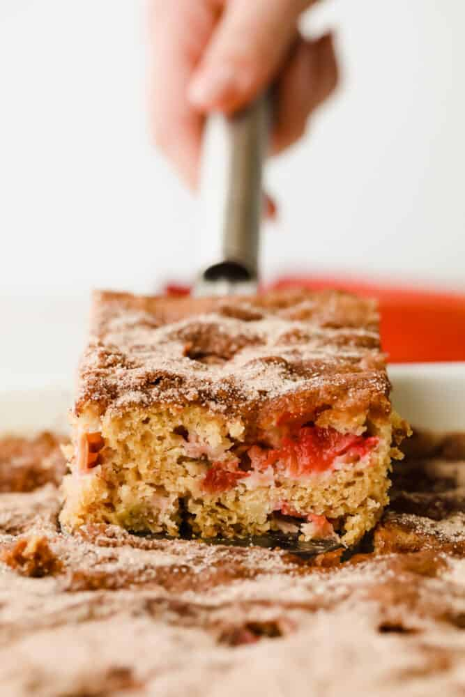 Rhubarb cake on a serving spoon.