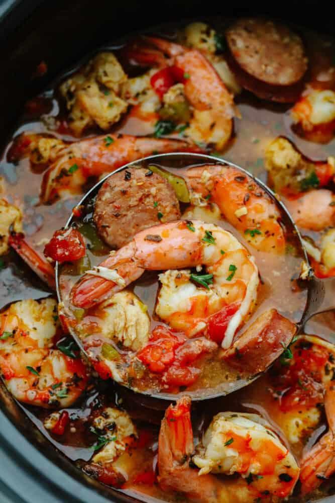 Scooping up shrimp and sausage in jambalaya.