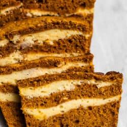 Slices of pumpkin bread with cream cheese swirls.