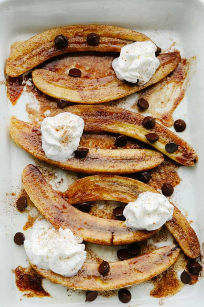 Sliced, baked bananas with toppings.