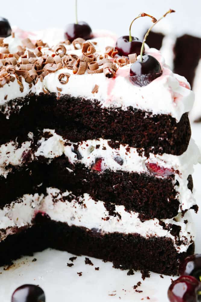 A black forest cake that has a slice taken out of it, showing the inside!