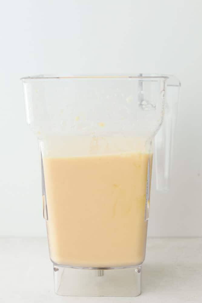A smoothie all blended up in a blender.